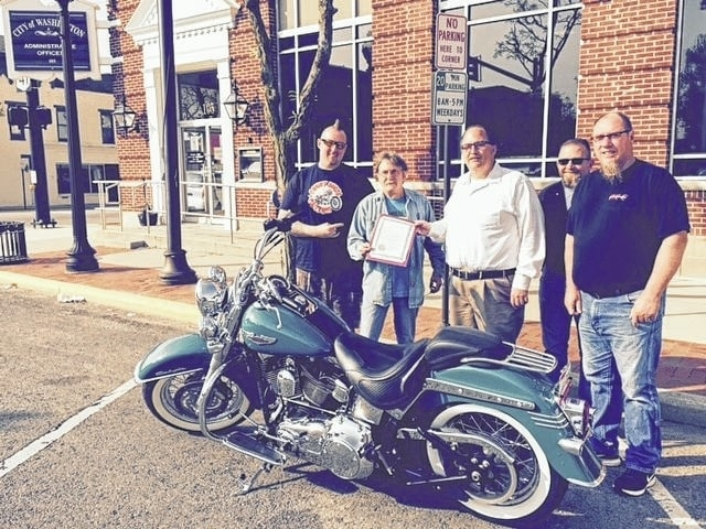 The City of Washington Court House recently declared May as Motorcycle Awareness month. Pictured in front of the city building (L to R): DJ Jenkins, co-owner of Court House Custom, Richard Williamson, Abate of Ohio, Joseph Denen, city manager, Jimmy Coldiron, Reds Custom Cycle and Gary Benson, Reds Custom Cycle.