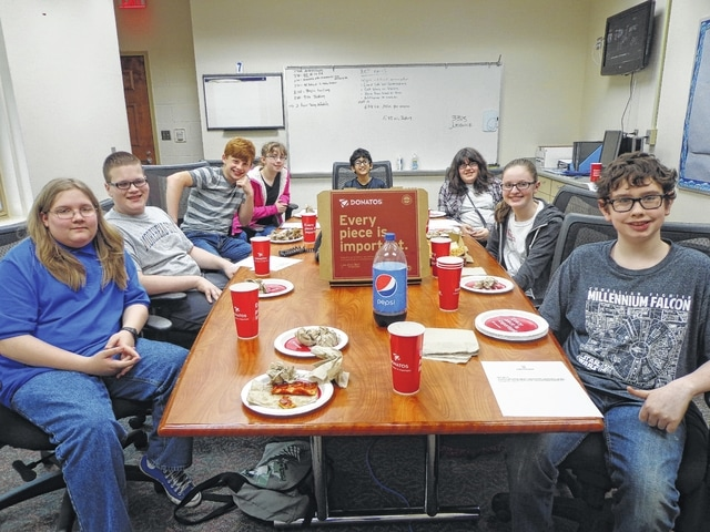 """Donatos recently provided pizza to these students at Washington Middle School as they celebrated """"Pizza with the Principals."""" This is in appreciation for their selection as Students of the Month for April. They are chosen by their teachers because of the outstanding example they set for their peers in such areas as academic effort, good work ethic, kindness to others, and service to their school. Pictured from left: Tyler Earley, Dakota Oyer, William Baughn, Kayla Sines, Kishan Patel, Sierra Rodriguez, Ashlynn Thevenot and Braeden Alberstein. Absent from picture – Skyler Gilpen."""