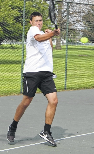 Miami Trace's Seth Leach hits the return during a first singles match against Washington's Ken Upthegrove at the Club at Quail Run Friday, April 29, 2016.
