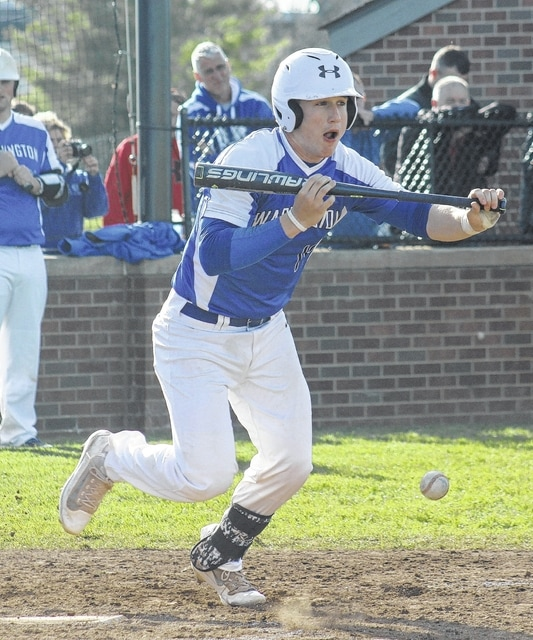 Washington's Tim Robinson drops down a bunt during an SCOL game against Miami Trace Wednesday, April 13, 2016 at Washington High School.