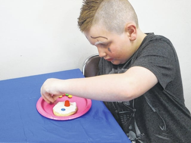 William Helsel is shown here creating his very own clown cookie during Clown School at Jeffersonville Branch Library.