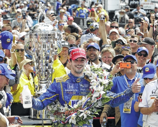 Alexander Rossi celebrates after winning the 100th running of the Indianapolis 500 auto race at Indianapolis Motor Speedway in Indianapolis, Sunday,.