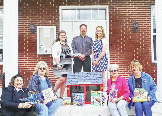 Showing off Altrusa's Little Free Library for school-aged children that will be installed in late May on the grounds of the Bloomingburg Town Hall are (from left) Altrusa's Past President Alice Craig, Bloomingburg Mayor Gayle Brown, Miami Trace senior Kaleigh Swayne, Miami Trace High School's ag instructor and FFA advisor Bruce Bennett, Miami Trace senior Sara Rowland, and the two Altrusans coordinating the club's literacy project: Jeannie Bihl and Janet Martin.