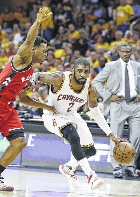 Cleveland Cavaliers' Kyrie Irving (2) drives on Toronto Raptors' Kyle Lowry (7) during the second half of Game 2 of the NBA Eastern Conference finals Thursday in Cleveland. The Cavaliers won 108-89.