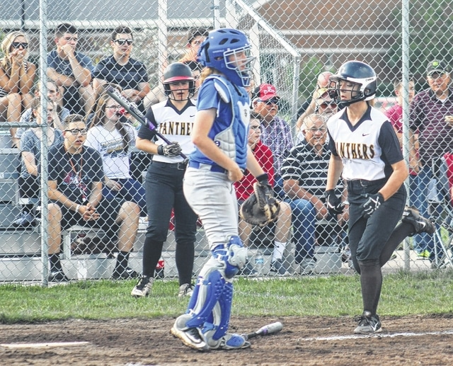 Ashley Campbell scores for Miami Trace in the bottom of the first inning of a Division II Sectional semifinal game against the Washington Lady Blue Lions at Miami Trace High School Wednesday, May 11, 2016. Also pictured is Washington catcher Maddy Jenkins and Miami Trace's Alexis Schwartz.