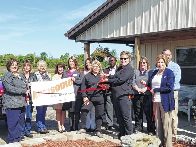 The members of the Fayette County Chamber of Commerce Ambassador Team recently welcomed a new member, Awesome Real Estate. They are pictured celebrating an official ribbon-cutting.