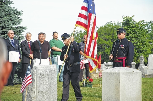 Henry Casey Camp No. 92 Sons of Union Veterans of the Civil War post the colors during the annual Bloomingburg Memorial Day service.