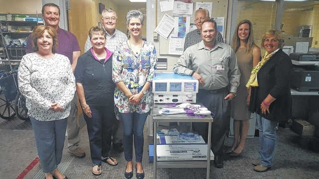 The Fayette County Memorial Hospital (FCMH) recently purchased a ForceTriad that will help meet the surgical needs of the community. Pictured are: Kathy Dean, FCMH Foundation Board Member, Dan Roberts, FCMH Foundation Board Member, Ron Ratliff, FCMH Foundation Treasurer, Dr. Norma Kirby, FCMH Foundation Secretary, Shannon Jacobs, FCMH Board Member, Roger Kirkpatrick, FCMH Foundation Board Member, Dr. Sarah Thompson, FCMH Foundation Board Member, Jason Vaughan, FCMH Director of Surgery, and Shirley Pettit, FCMH Foundation Board Member.