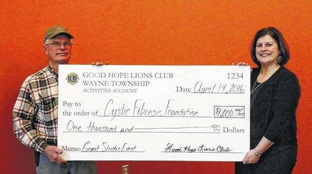 The Good Hope Lions Club makes a $1,000 donation for the third consecutive year. Lions member Jim Garland presents the check to Chyane Collins (Washington CH Great Strides event coordinator).