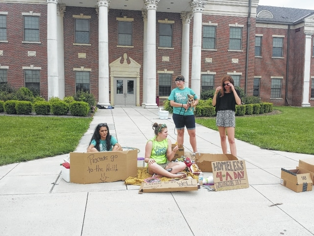 "The Washington High School Hi-Y Club took their first day of summer Thursday to raise money for The Well at Sunnyside by collecting money as ""Homeless for a Day,"" in front of the school. The money will go toward fighting homelessness and help the community through The Well's many programs."