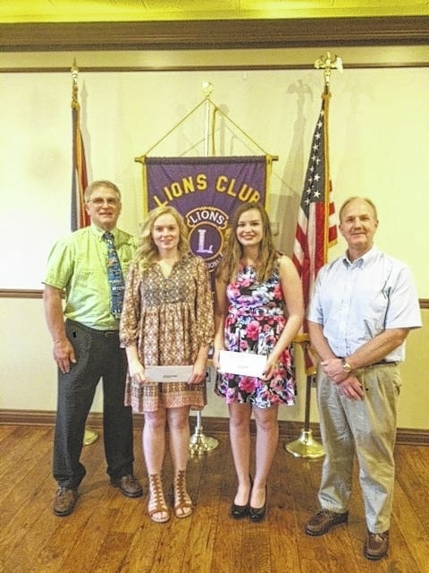The Washington Lions Scholarship Chairman Ray Deeks, with scholarship recipients Olivia Buckner and Mary Climer, flanked by speaker Paul LaRue.