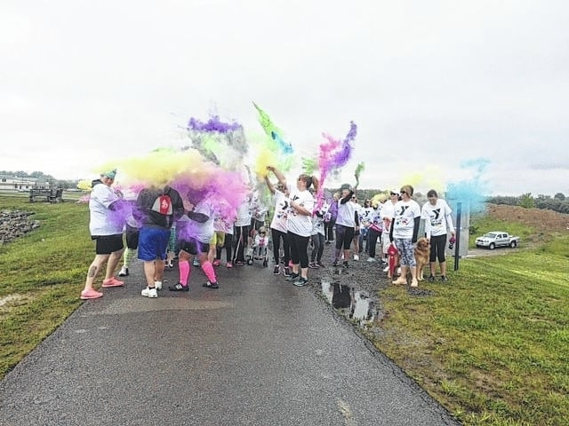 "The Fayette County Family YMCA hosted a ""Color Run"" Saturday at the reservoir behind their building."