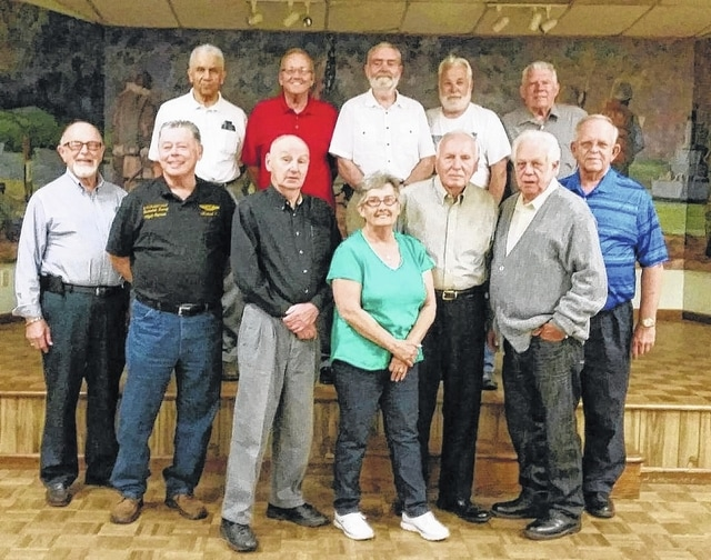 """Members of the Fayette County Honor Guard met recently for their annual dinner gathering. Back row, from left to right, Charles """"Buck"""" Harris, John Mason, Bill Footy, Glenn Rankin and Tom Slager; front row, left to right, Paul Sands, Mike Curl, Dave Frederick, Patty Deweese, Ed Fisher, Eddie Wheaton and Sheldon Litton."""