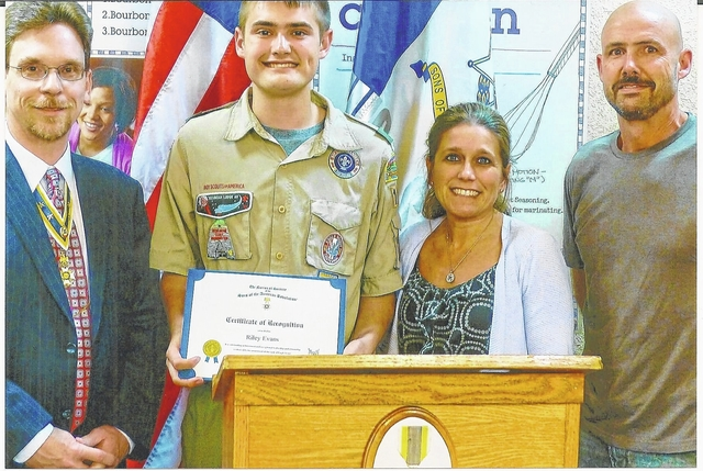 Shawn A. Cox, (left) vice president of the Ohio Society Sons of the American Revolution (SAR), present a certificate of Recognition to Eagle Scout Riley Evans, the winner of the of the Arthur St. Clair Chapter (SAR) Arthur M. and Berdena King Eagle Scout Contest. Pictured with Riley are his parents: Rachel and Todd Evans.