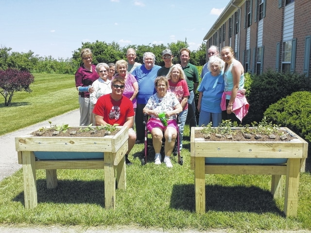 Seton Senior Living was gifted two vegetable planters from the Miami Trace FFA after an idea from residents sparked the work that provided them. The planters were designed and built by students with the residents in mind. Several students met on Tuesday to set the planters up and talked with residents who gave them many thanks.