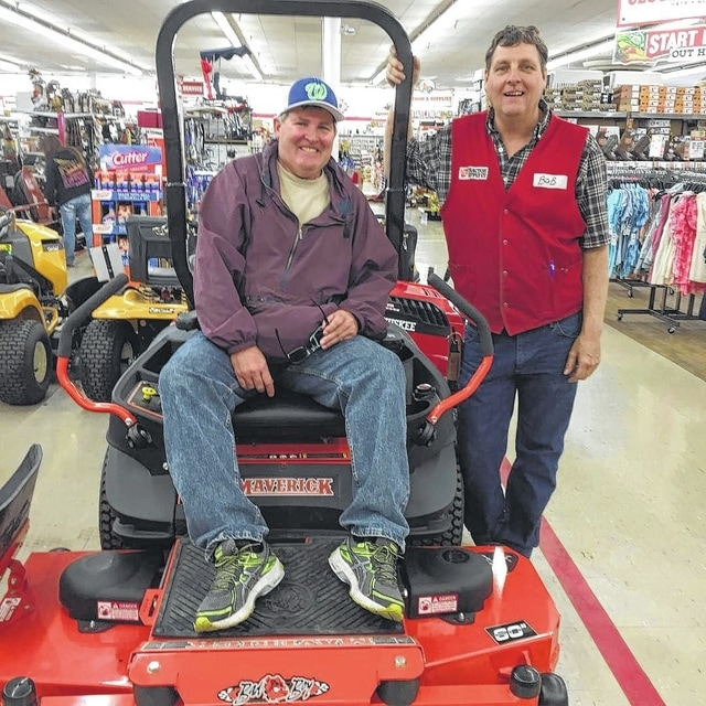 Bob Elrich is pictured with Bob Minzler, Tractor Supply Company (TSC) store manager, after he won a drawing for a new Badboy Mower recently.
