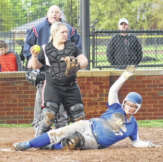 Taylor Harrington slides safely into home for Washington in the fifth inning of a game against Waverly Wednesday, May 4, 2016.