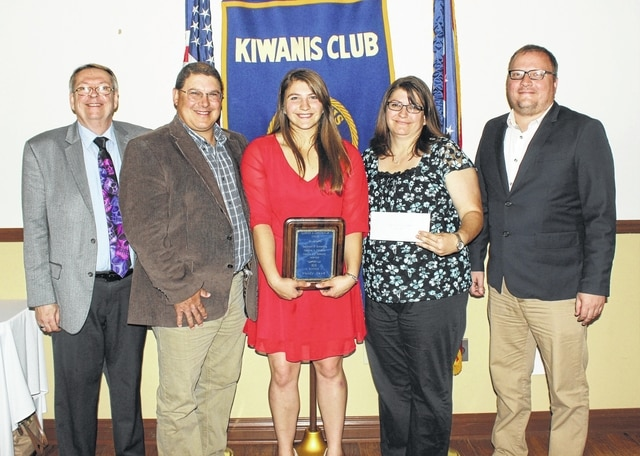 Wendy Hawk, center, is flanked by her parents and representatives of the local Kiwanis Club and the Record-Herald after receiving the 48th Annual Clarence A. Christman Jr. Award Tuesday, May 24, 2016. (l-r); Gary Brock, representing the Kiwanis Club, Don, Wendy and Holly Hawk and Ryan Carter, editor of the Record-Herald.
