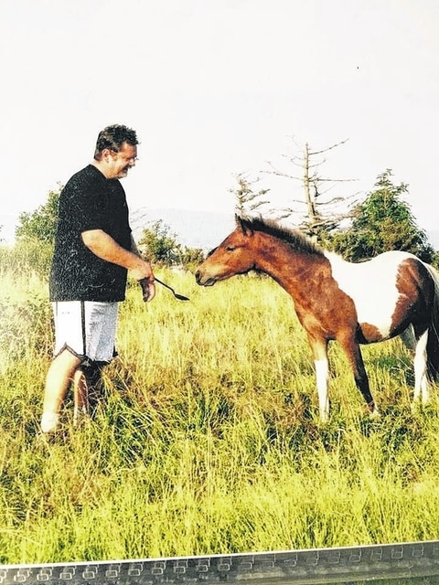 Dr. Powell and a wild pony along the Appalachian Trail.