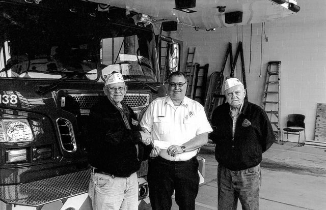 The VFW Post 3762 donated recently to Fire In The Sky. Pictured (L to R): Sheldon Litton, Washington Fire Chief Tom Youtz and Bob Malone.