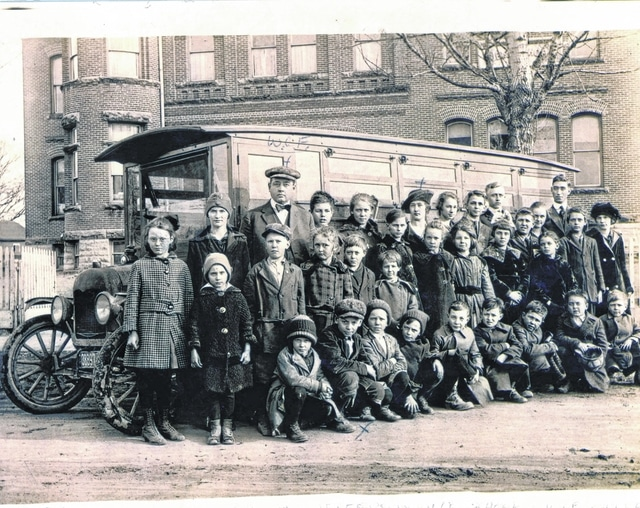 This 1909 photo shows the old Jeffersonville High School in the background. Assembled are students and teachers from that time in front of what might have been one of the first school buses in the county. This photo is courtesy of Phil French, whose grandfather (back left) was not only a teacher at the Jeffersonville School but was also the bus driver and owner of the bus.