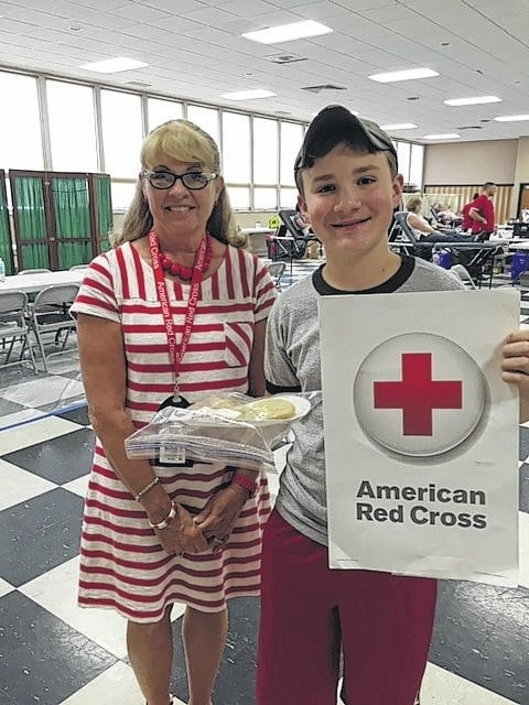 The 4-H Fun Bunch 4-H club made and donated cookies for the American Red Cross Blood Drive that took place at Grace United Methodist Church on June 14. Pictured are Miracle Holsinger, Red Cross representative, and Drew Black, 4-H Fun Bunch Community Service Officer.