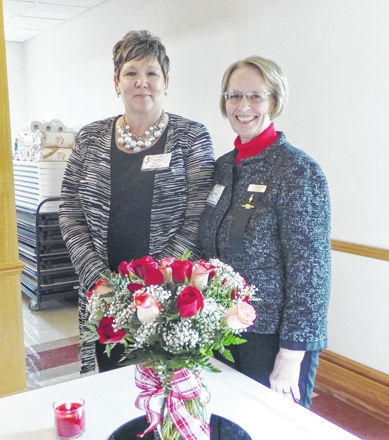 Prior to the installation ceremony, Anne Quinn (left), DKG's incoming president, meets with the local chapter's outgoing president, Diana Kirkpatrick. Old and new officers each received a long-stemmed rose in appreciation for their service past and to come.