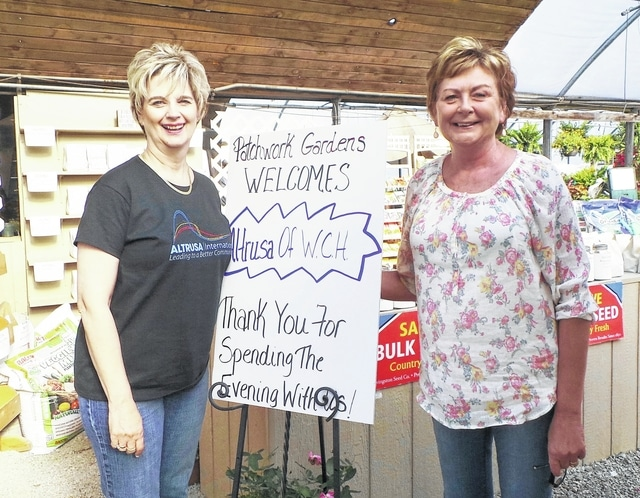 "Gamma White and Brenda Mossbarger, two well-known local businesswomen and longtime members of Altrusa International of Washington C.H., Inc., stand beside a welcome sign at Patchwork Gardens as members of the club arrive for a late-May outing to the Wilt family greenhouses. The evening started with a picnic supper supplied by BB's Cakes & More, continued with a demonstration on different types of flowers for various settings, then concluded with the club members being set loose to select flowers for planters of their own. Employees of the business stayed after hours to assist. Most of Altrusa's program meetings during the year feature organizations or projects to which the community service organization can donate money or volunteer to contribute labor—this was a rare just-for-fun ""spring fling"" to end the club year. The committee that will begin working most industriously during the summer will be the Service/Loving Spoonsful Committee members, as they take charge of the local club's major annual fundraiser. The tasting luncheon has attracted ever more patrons during the previous five years, with increasingly large sums of money duly donated to three selected local causes. This year's benefit is scheduled for Oct. 8 at the Commission on Aging."