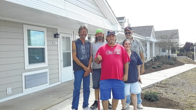 Residents returned home Thursday to the Fayette Landing. Back row (left to right): Sylvio Angeletti, Will Mahorney, Dan Ault. Front row: Doug Elkins and Leighann Lawson.