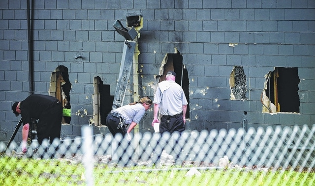Police officials investigate the back of the Pulse nightclub after a shooting involving multiple fatalities at the nightclub in Orlando, Fla., Sunday. Authorities say Omar Mateen used an AR-15 to fire relentlessly at patrons of the nightclub— 20 rounds, 40, then 50 and more. Mateen then shot at police. He took hostages. When the gunfire stopped, 50 people were dead and dozens wounded in the deadliest mass shooting in modern U.S. history.