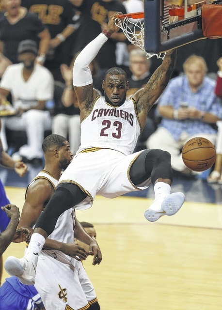 Cleveland Cavaliers forward LeBron James (23) dunks against the Golden State Warriors during the first half of Game 6 of the NBA Finals in Cleveland on Thursday.