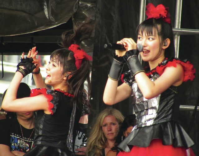 Babymetal lead singer Suzuko Nakamoto and backup singer Moa Kikuchi perform at the 2015 Rock on the Range in Columbus. The Japanese heavy metal j-Pop fusion band returns to Columbus next month as one of the hottest acts in rock for the Alternative Press Music Awards show.