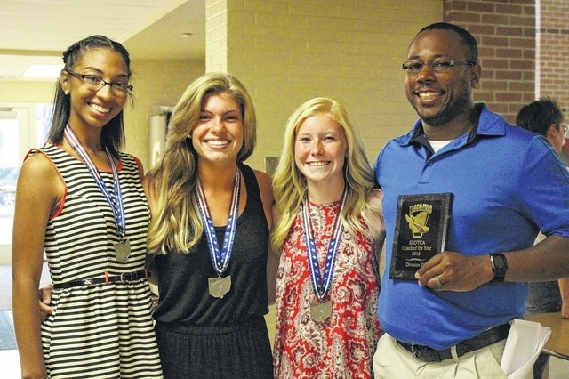 Three Washington Lady Blue Lion track athletes and their coach attended the Southeastern District Track Awards banquet Monday, June 6, 2016. The ladies were honored as First Team, All-District in the 4 x 1, 4 x 2 and 4 x 400-meter relays, as well as Alexis Gray in the 400-meter dash. Student-athletes recognized from Washington were: Maddy Garrison, Gray, Megan Mullins, Haley Petitt, Holly Inskeep and Maria Wilson. And from Miami Trace, District shot put champion Katie Seyfang was recognized. Washington head coach Louis Reid was named Division II Girls Coach of the Year from the Southeast District. (Above, l-r); Maria Wilson, Megan Mullins, Maddy Garrison and Louis Reid.