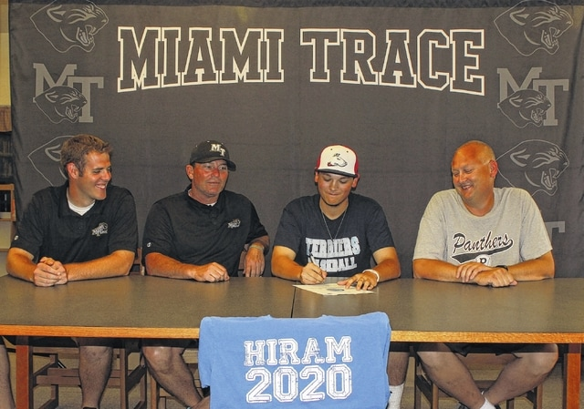 Drew Stevens, third from left, signs a letter of intent to play baseball for Hiram College. He was joined by (l-r); Miami Trace assistant baseball coach Matt Platt, head coach Rob Smith and Stevens' dad, Shawn.