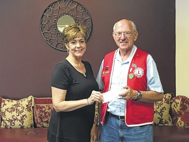 Cheryl Stockwell, director of the Fayette County Commission on Aging, was presented a check from the New Holland Lions Club by club treasurer, Lion Paul Edgington . Funds are raised from their annual soup supper, Lions Mints and broom sales.