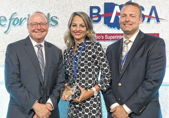 """Sarah Kirkpatrick, a Miami Trace kindergarten teacher, was recently honored as a Battelle for Kids """"Distinguished Educator."""" Jim Mahoney (left), executive director of Battelle for Kids, presented the award to Kirkpatrick, who is also pictured with her husband, Brent Kirkpatrick."""