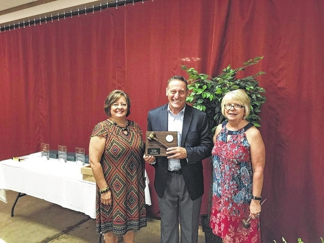 Chamber board chair for the past year, John Hedges of Flagway, passed the gavel to the new chair, Merleen Van Dyke (right) of Jim Van Dyke's Automotive & Tire Center, at Wednesday's Chamber annual luncheon. Chamber president Whitney Gentry is also pictured.