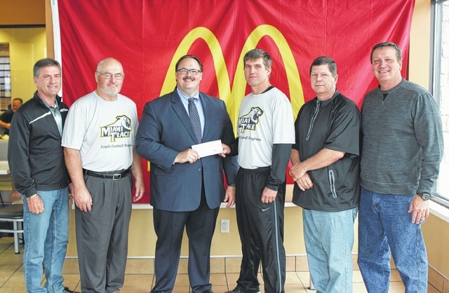 Nick Epifano, owner/operator of the local McDonald's, recently made a donation to the Miami Trace Youth Football League. Pictured are Jeff Spears, Keith Guthrie, Nick Epifano, Rob Guthrie, Jeff Conroy and Dan Roberts.