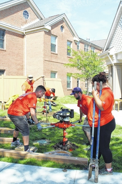 Members of Team Depot from the Washington C.H. Home Depot store spent Tuesday volunteering at National Church Residences Mill Run, a senior living community in Hilliard. Team Depot installed a fence, donated by Home Depot, that will surround a Tranquility Garden designed to help Mill Run residents who suffer from Alzheimer's and dementia. Pictured are, left to right, Tim Hodson, of Washington C.H., Sam Matthews, of Washington C.H., Michael Capretta, of Columbus, Michael Clifton, of Springfield, and Sarah Boston, of Washington C.H.