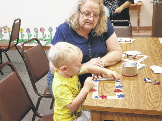 Cole Yenger enjoys creating a Star Wreath at Miss Linda's Craft Workshop at Jeffersonville Branch Library.