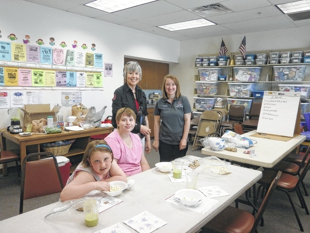 Pat Brinkman, Fayette County OSU Extension Agency Nutrition Director, and Sarah Sowell, Fayette County OSU Program Assistant Snap-Ed, made fun food at Jeffersonville Branch Library recently. Lilly and Holly Lewis enjoyed the program very much.