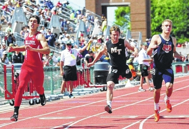 Miami Trace junior Drake Litteral (center) crosses the finish line in the finals of the 200-meter dash at the Division II State track meet Saturday, June 4, 2016 at the Jesse Owens Memorial Track at The Ohio State University.