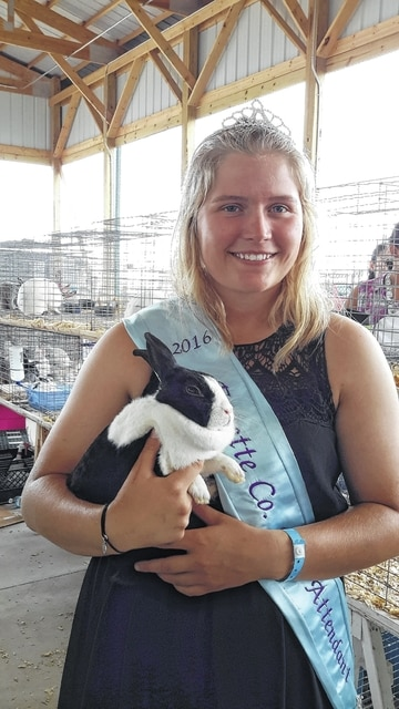 Alexis Schwartz and her Dutch rabbit. Schwartz was the overall rabbit showman winner on Monday.