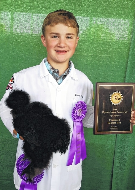 Drew Black, with his bantam silky hen, was named the overall best of show breeding bird.