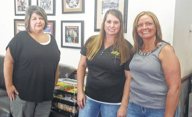 From left to right: Katie Bottorff, Record-Herald General Manager, Tess Sievertsen, Cash Max Manager, and Angie Manns, Cash Max District Manager.