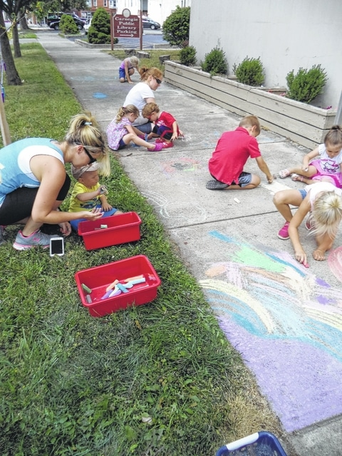 Sidewalk art and popsicles made for a great day at the library recently.