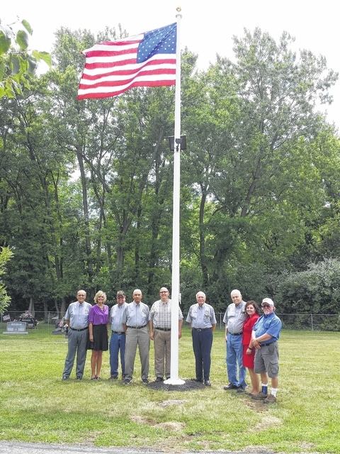 Members of the Fayette County Veterans Service Commission, Washington Court House City Manager Joe Denen, and DAV Treasurer Bob Draves (at right), were on hand at the Washington Cemetery during a dedication Thursday afternoon of the flag and pole donated by the DAV in conjunction with the Washington Cemetery.