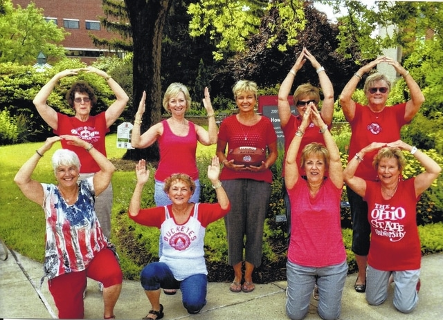 Pictured are the Deer Creek Daisies Garden Club who showed their school spirit by spelling out a double block O-H-I-O (L to R): O Julie Schwartz and Barbara Vance; H Marty Cook and Emily King; middle garden guest Tawana Zimmerman; I Rita Lanman and Billie Lanman; O Connie Lindsey and Judy Gentry.