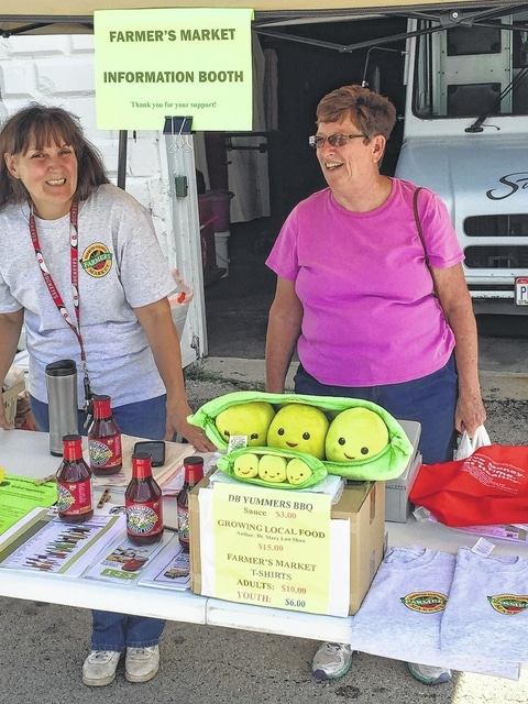 Debra Grover (on left) enjoys being the Fayette County Farmers Market information person.
