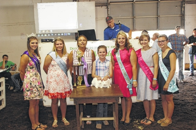 Meghan Cory's reserve champion pen of three rabbits sold for $1,400 at Wednesday's Fayette County Rabbit Sale. Pictured with Cory (center) are buyers and fair royalty: Fair Queen Bethany Reiterman, Fair Attendant Alexis Schwartz, Mandy Williams, owner of 3-C Cab, Small Animal Queen Macy Detty, Fair Attendant Virginia Schappacher, and Fair Attendant Ginna Climer.